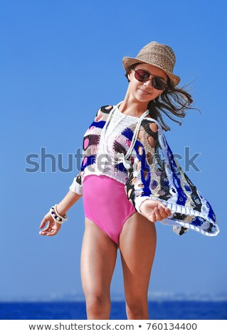 woman and girl in swimsuit on a dock stock photo © is2