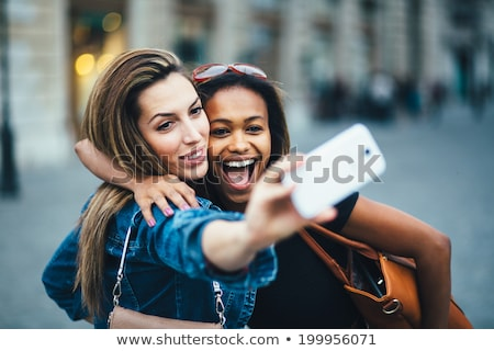 young female friends taking selfie stock photo © wavebreak_media