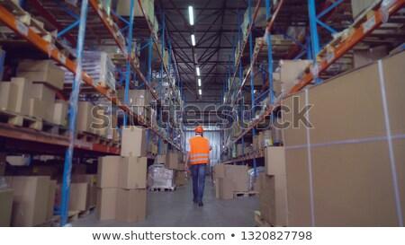 üzletember védősisak hordoz mappa férfi fal Stock fotó © IS2