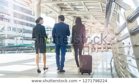 Business people cheering on walkway Stock photo © IS2