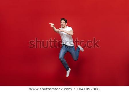 Tam uzunlukta portre mutlu adam işaret parmak Stok fotoğraf © deandrobot