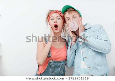 teenage couple blowing bubble gum bubbles stock photo © is2