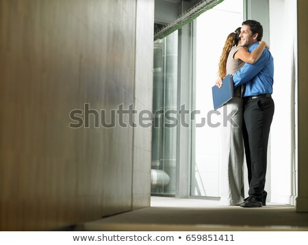 A woman hugging a man in a hallway Stock photo © IS2