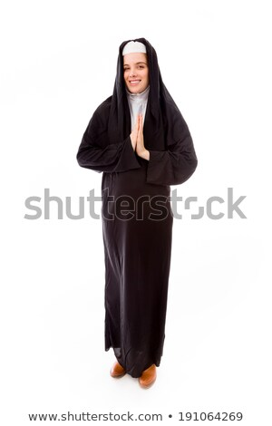 Portrait of nun clasping hands Stock photo © IS2