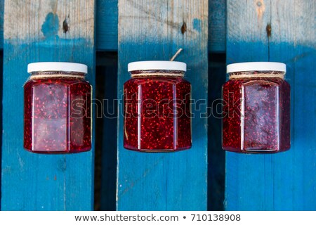 Jar filled with fresh berries Stock photo © dash