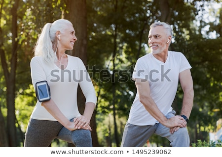 couple warming up for a workout in the city stock photo © kzenon