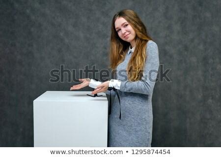 Figyelmes barna hajú szürke zokni pózol szék Stock fotó © acidgrey