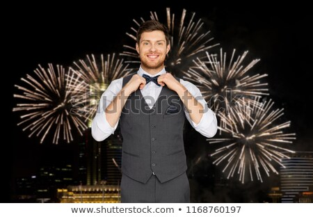 man in festive suit over night city lights Stock photo © dolgachov