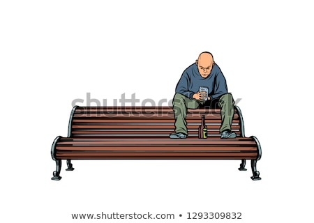 skinhead bully sitting on a bench with a bottle Stock photo © studiostoks