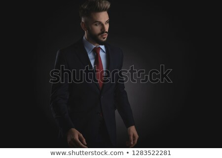 handsome businessman in awe looks to side  Stock photo © feedough