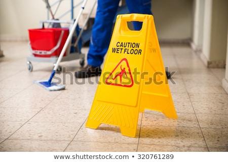 Takarító áll vigyázat nedves padló felirat Stock fotó © AndreyPopov