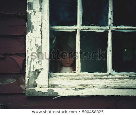 girl scared of haunted house with ghosts stock photo © colematt