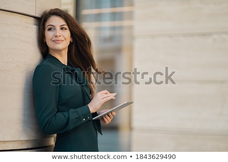Attractive Young beautiful entrepreneur Woman smiling and lookin Stock photo © snowing