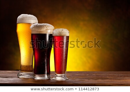 Cold glasses of lager ale beer with foam  Stock photo © DenisMArt