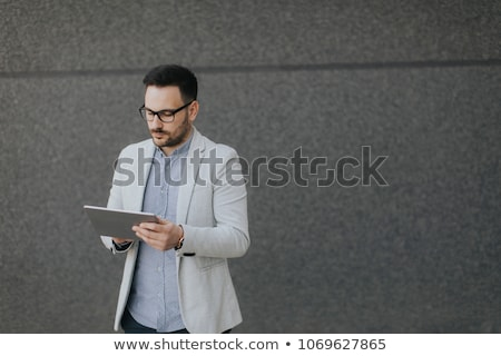 financial district and man using tablet Stock photo © nito