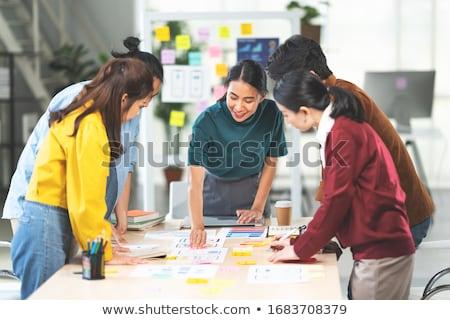 Team of people building or designing computer app. Stock photo © jossdiim