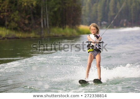 Child learning to water skiing on a lake Stock photo © Lopolo