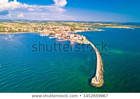 Historic town of Umag and harbor breakwater aerial view stock photo © xbrchx