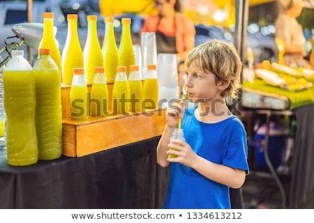 Fiú iszik cukornád dzsúz ázsiai piac Stock fotó © galitskaya