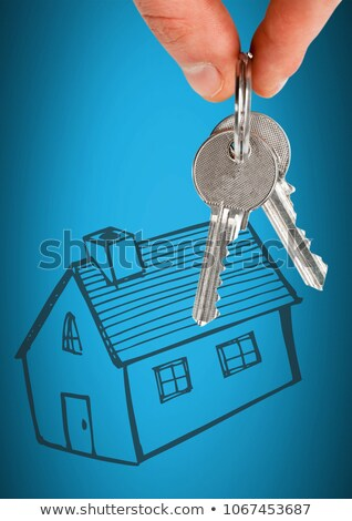 Stockfoto: Hand Holding Key With House Home Drawing In Front Of Vignette