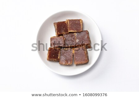 Cubes of natural brown and white and caramelized unrefined sugar cubes on white background. macro Stock photo © DenisMArt