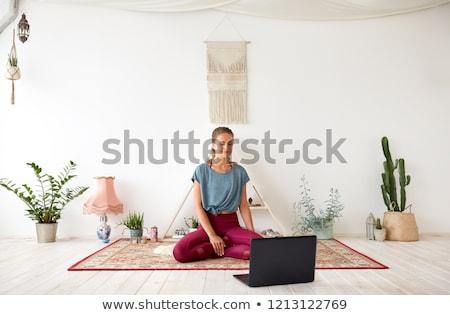 woman with laptop computer at yoga studio Stock photo © dolgachov