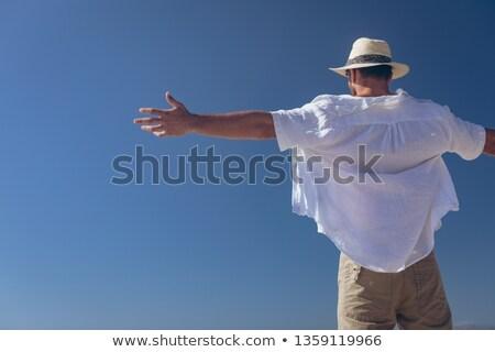 Hátsó nézet fiatal kaukázusi férfi áll tengerpart Stock fotó © wavebreak_media