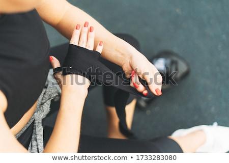 Imagem ativo mulher treinamento luvas de boxe mão Foto stock © deandrobot