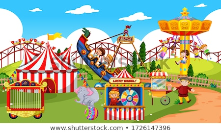 Themepark scene with many rides and happy children Stock photo © bluering