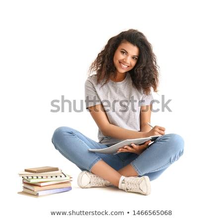 Belle afro jeune femme cheveux bouclés séance Photo stock © boggy