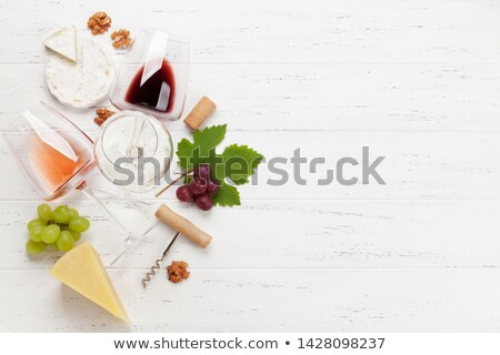Various grapes, wine and corkscrew Stock photo © karandaev