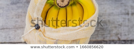 Fruit in a reusable bag on a stylish wooden kitchen surface. Zero waste concept, plastic free concep Stock photo © galitskaya
