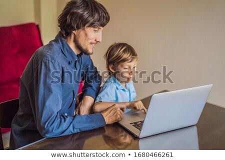 Boy studying online at home using laptop. Studying during quarantine. Global pandemic covid19 virus Stock photo © galitskaya