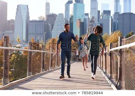 group of young people jump on footbridge Stock photo © Paha_L