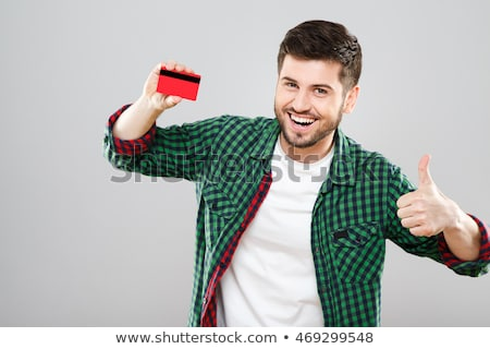 man in red shirt with card in hand stock photo © paha_l
