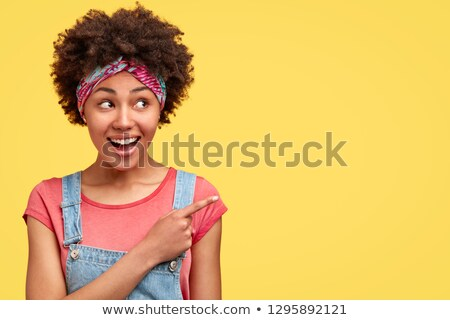 Cheerful woman in dungarees Stock photo © photography33
