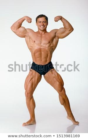 jóképű · testépítő · pózol · égbolt · szexi · sport - stock fotó © konradbak