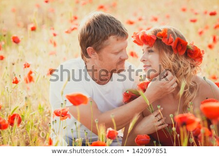 Couple with wild flowers stock photo © photography33