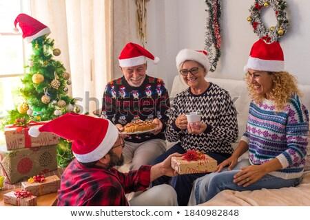 Fiatal nő ajándék idősebb férfi ház boldog Stock fotó © photography33