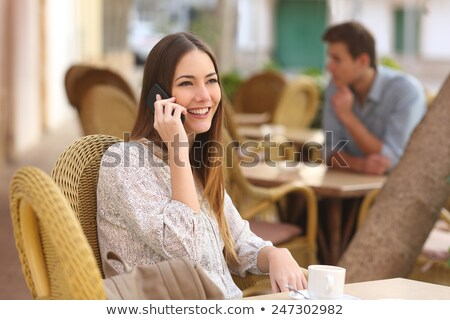 Young women breakfasting outside and taking a call Stock photo © photography33
