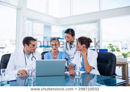 Nurse sitting at a computer stock photo © photography33