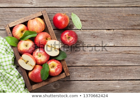 ripe red apple on table and green leaves stock photo © inaquim