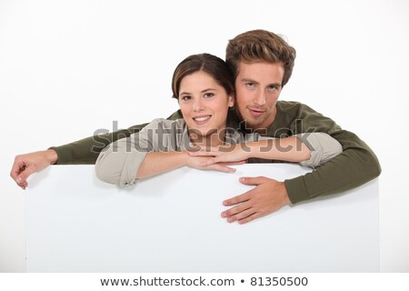 20 years old man and woman man is surrounding the woman with his arms stock photo © photography33