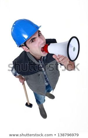 angry craftsman shouting through a megaphone stock photo © photography33