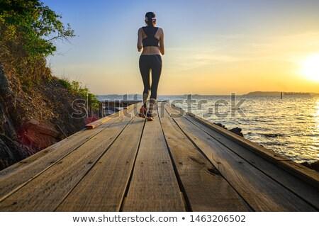 Young Women Running on Beach Trail stock photo © Schmedia
