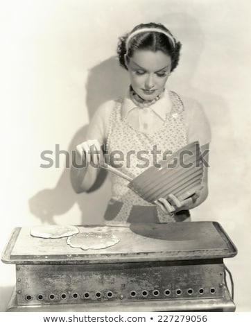 Young woman preparing meal on a griddle Stock photo © photography33