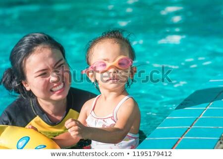 Pár néz kamera vmi mellett úszómedence nő Stock fotó © wavebreak_media