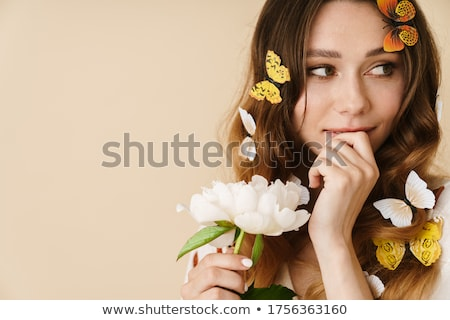 Photo of beautiful woman guessing with flowers Stock photo © Elmiko