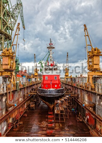 Stock photo: ship for repairs in large floating dry dock