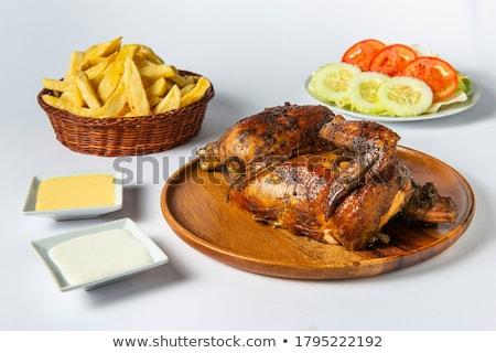 Golden chicken with fresh salads Stock photo © jrstock